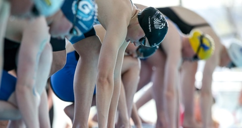 Buy tickets for the ASA Nationals. Picture of swimmers on the block.