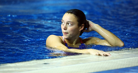 Woman tired swimming. Learn how to hold off swimming fatigue.