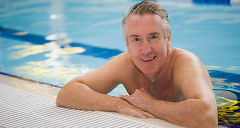 Middle-aged man. Leaning on pool edge. ASA Dementia Project gains government funding