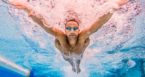 Man swimming. Swimfit is now available at Nuffield Health.