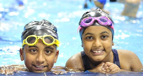 Two children in swimming pool. Find out which schools won the ASA school swimming grants.