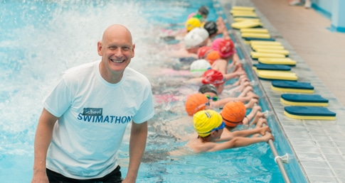Duncan Goodhew inspires pupils in the pool.