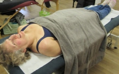 How does a sports massage help swimming recovery?