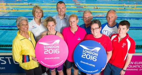 Masters swimmers with badges announcing London 2016 European Masters Championships dates.