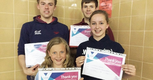 Swimming volunteers with certificates. Used on Rewarding and Recognising volunteers page.