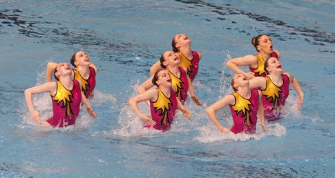 Entries open for 2015 NAG Synchro. Synchro swimmers performing team routine.