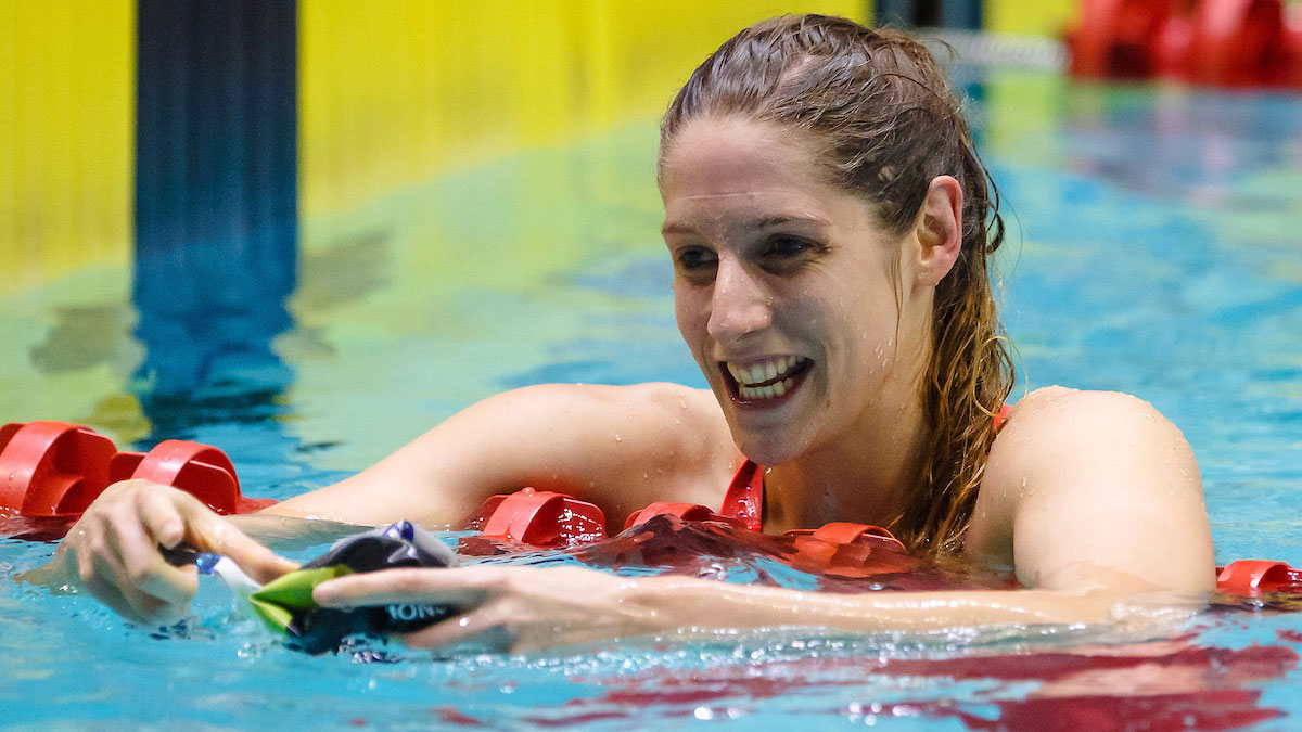 Masters swimmer Emma Gage smiles after a swimming race