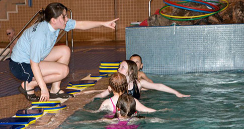Swimming teacher taking class. Check out the latest swimming jobs.