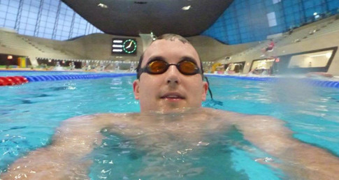 Bernard Greenwalker,with goggles on, ready to swim in the pool