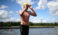 Open water swimmer emerges from water. Used for Swim England Open Water National Age Group Championships entry page.
