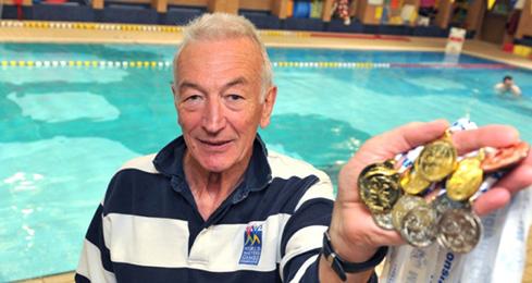 Len Phoenix wins 1000th swimming medal