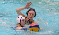 Mid Sussex Marlins' Daisy Hazeldine keeps her eyes on the ball under pressure.