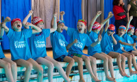 Pupils get excited for the Big School Swim on poolside and let out a cheer.