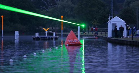 A laser lights the way for the Henley Classic swim