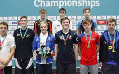 Fraser Scott eases 1500m freestyle title