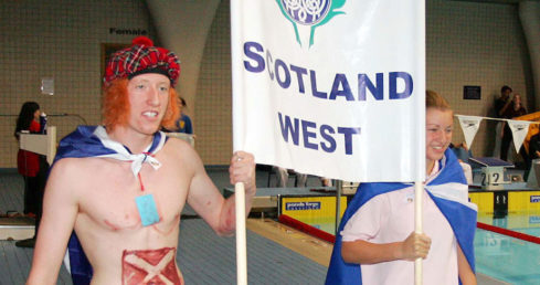Scotland West swimmers carrying the flag