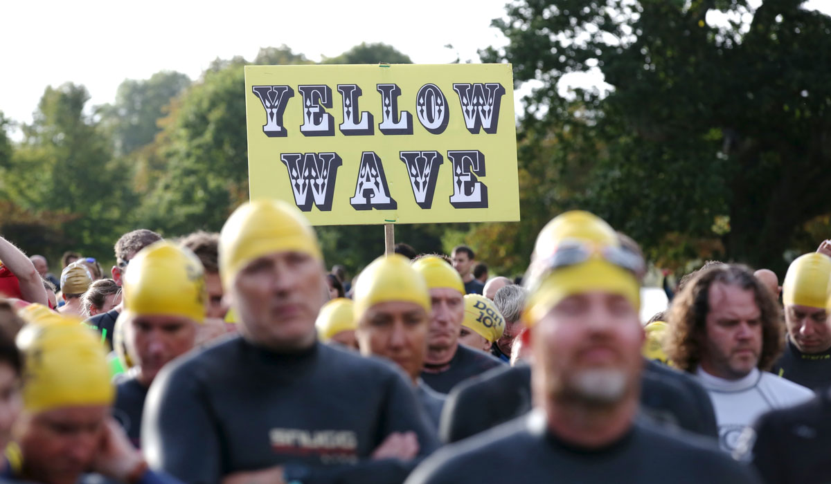 Yellow Wave sign at the start of the Dart 10k open water swim
