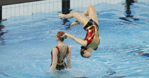 Leeds synchronised swimmer performing backflip