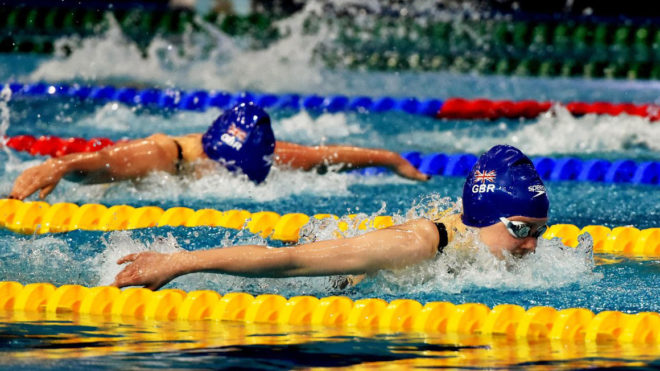 Emily Large sets junior record for butterfly gold