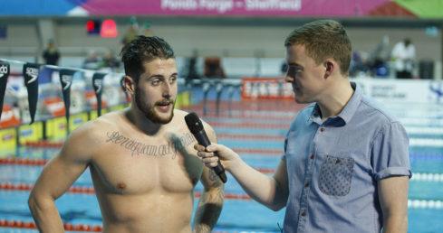 Walker-Hebborn interviewing after 50m Backstroke gold