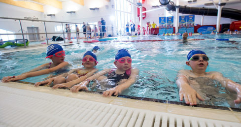 Image of children learning to swim.