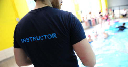 Man wearing t shirt with instructor on it. Used for story about Awarding Body roadshows
