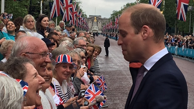 The Duke of Cambridge talks to swimming volunteers at The Patrons Lunch