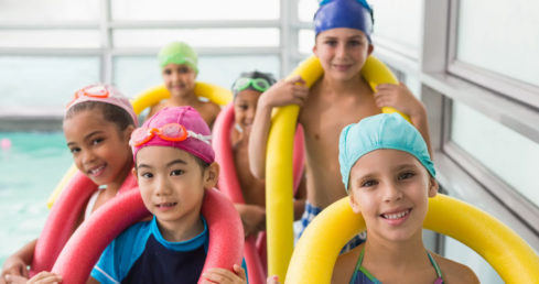 Children holding floatation aids on the Swim England Educator and Approved Centre Conference 2017 page