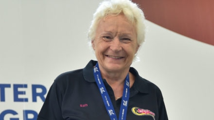 Kath Tunnicliffe completes hat-trick of backstroke titles