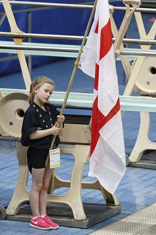 Image of young volunteer with flag.
