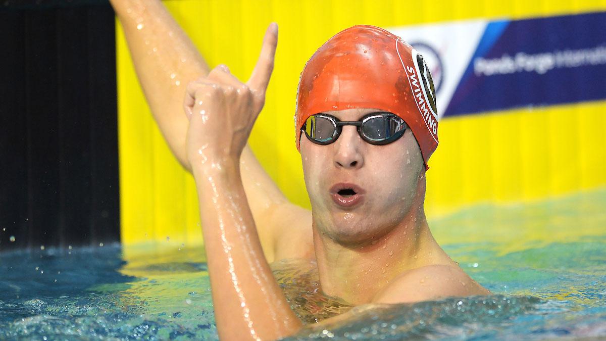 Joel Thompson celebrates winning Summer Champs gold