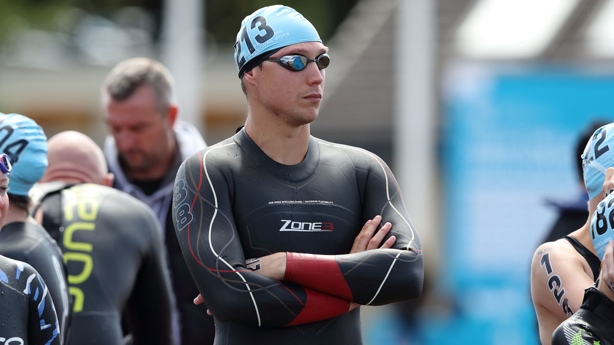 Open water swimmer Grant Turner with arms folded at an open water event