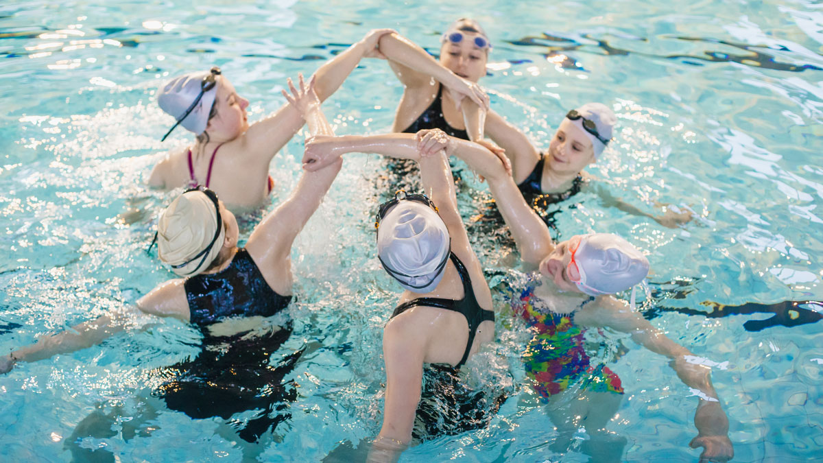 Synchronised swimmers at a training session in the pool