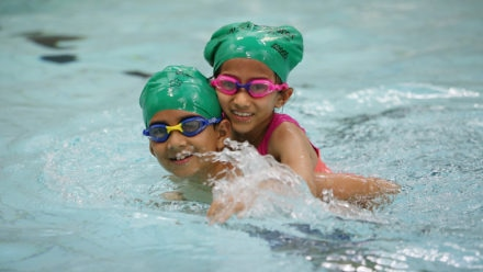 Swimming industry urges families to put down the screens and pick-up their goggles