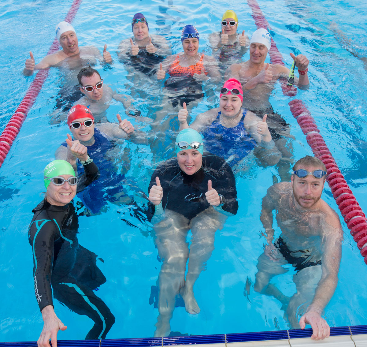 Masters swimmers give a thumbs up at Charlton Lido