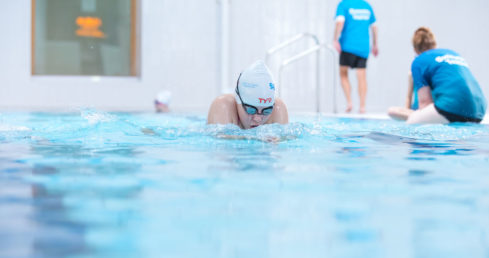 Boy swimming breaststroke.