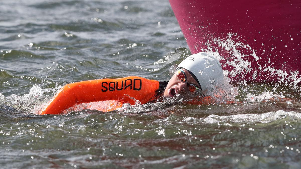 Boy swimming in open water