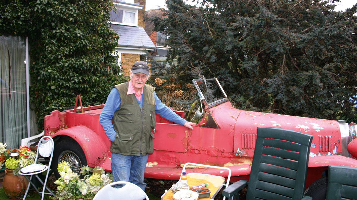 Trevor Baylis with his old car.