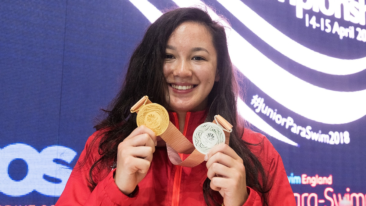 Alice Tai with medals