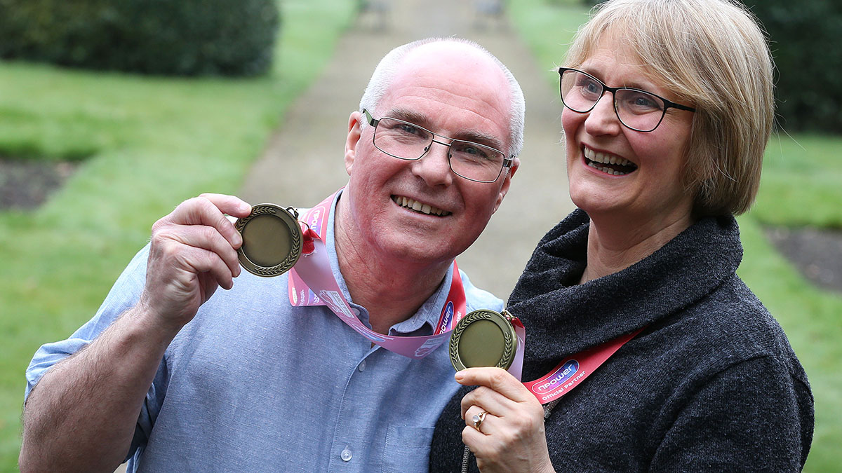 Jackie and David Laugher with medals of recognition