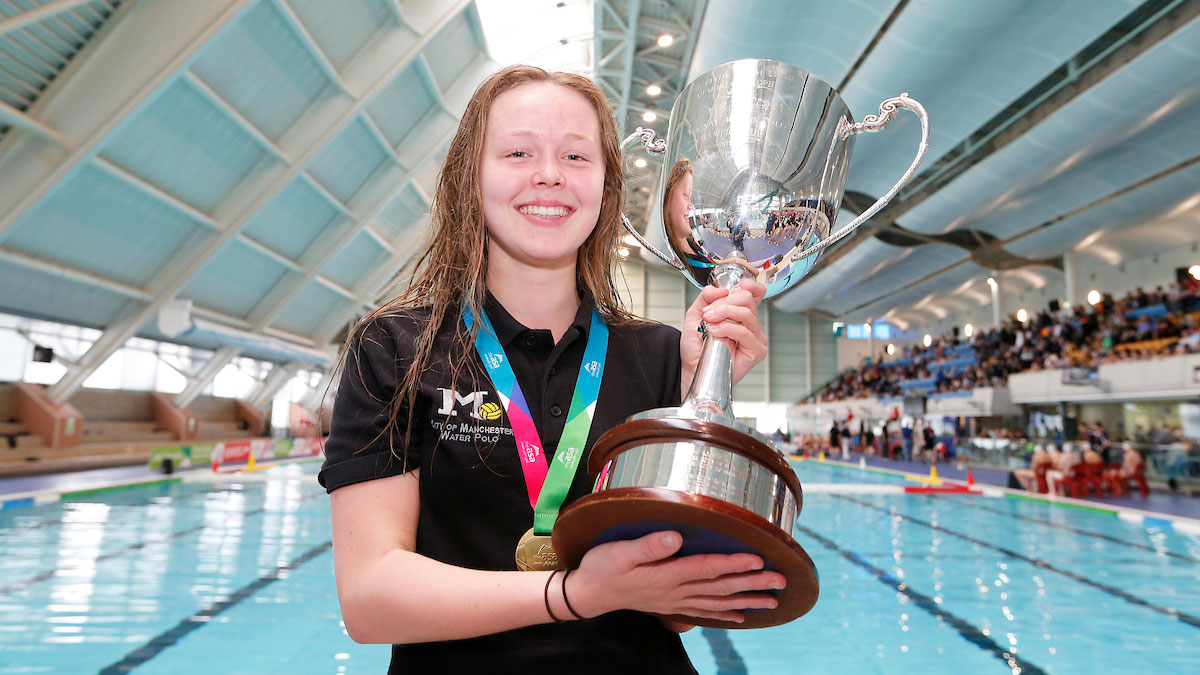 City of Manchester captain Emmie-Rose Eastwood lifts the Edith and Tom Lythe Memorial Trophy after City of Manchester win NAG Water Polo 2016 U17 Girls gold