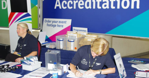 Swimming volunteers at the accreditation desk. Used for news story about #BigThankYou campaign