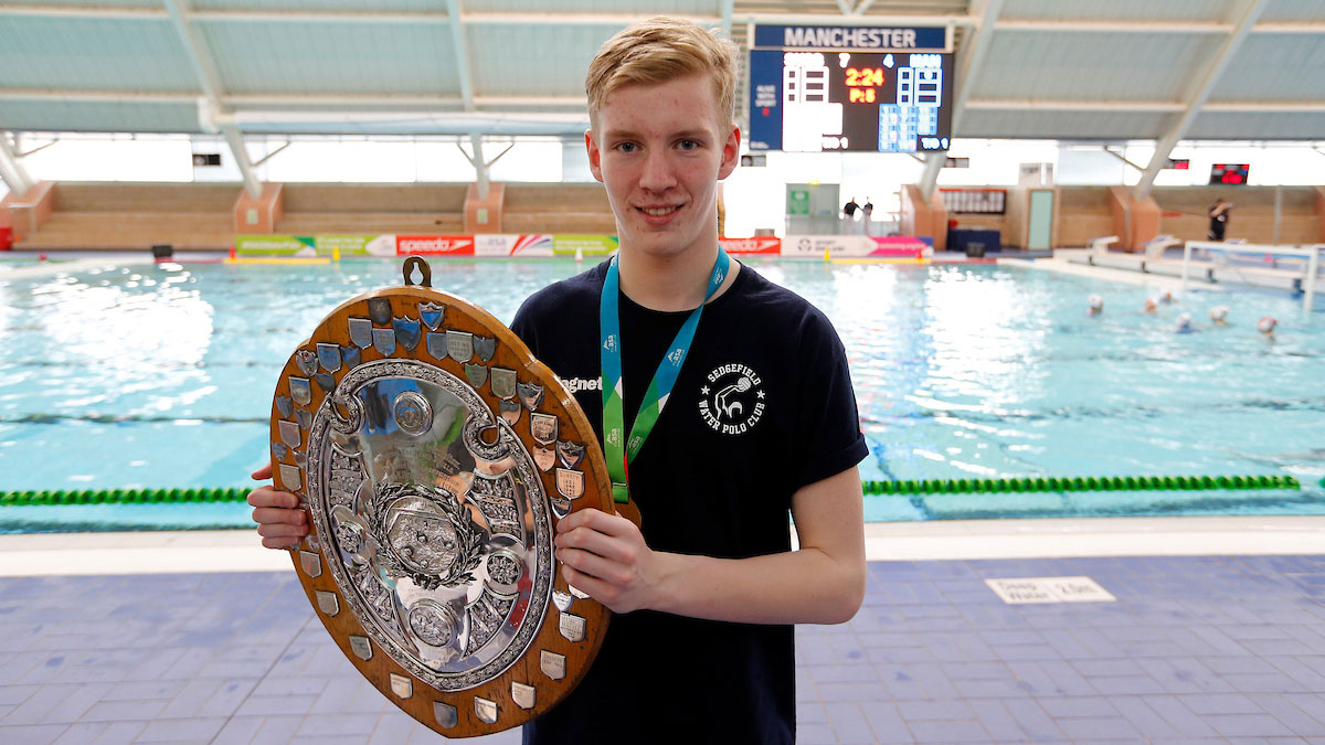 Sedgefield's Michael Cousins with the W.J. Read Trophy after winning U17 gold at the NAG Water Polo Champs 2016