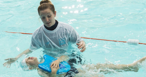Tutor Training Programme 2017 page displays swimming teacher training child in water.