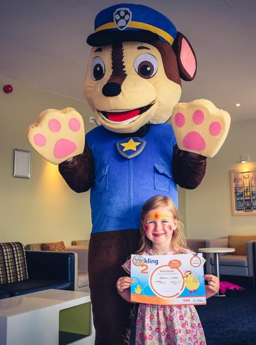 Little Lady shows off her new Duckling Award with Chase from Paw Patrol.