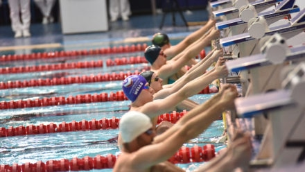 Wells makes it four with 100m Back title