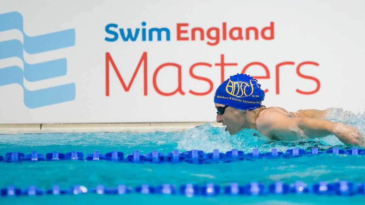Butterfly swimmer in front of Swim England Masters branding.