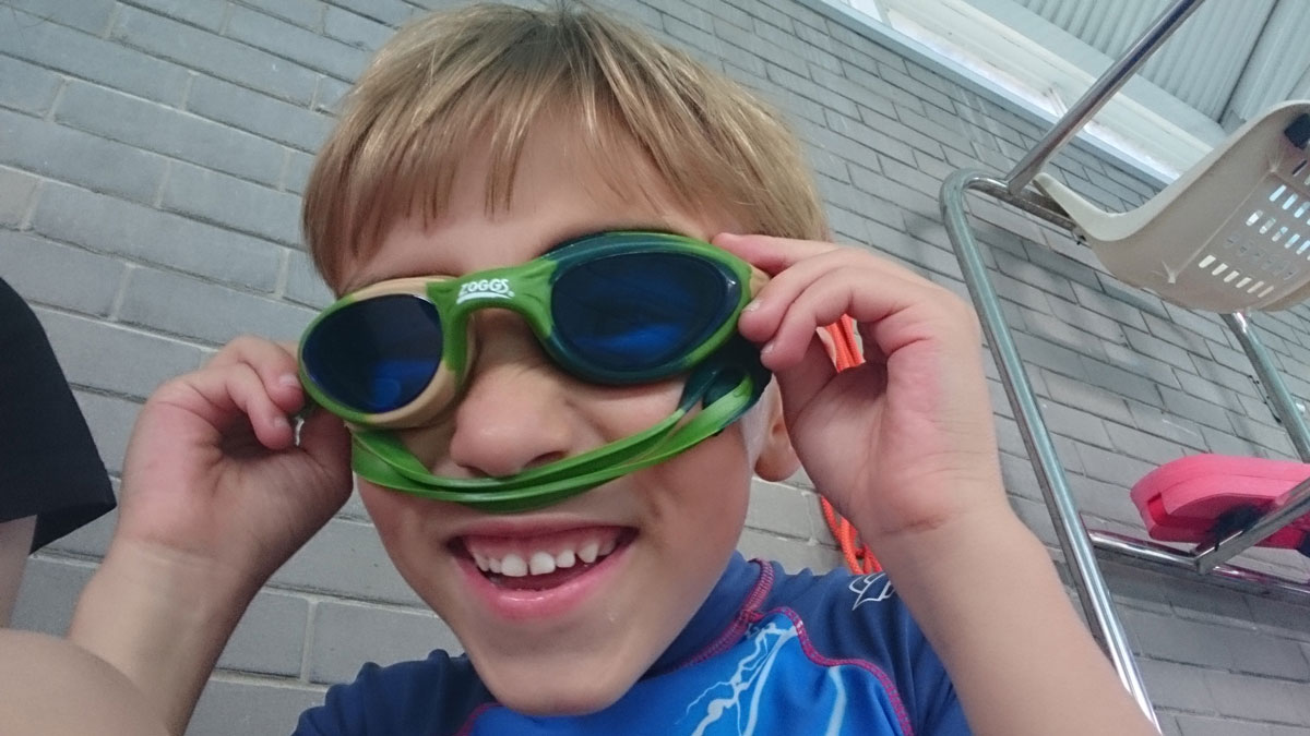 Jack holding a pair of goggles. From Enthusiasm For Water blog on Learn to Swim companion website.
