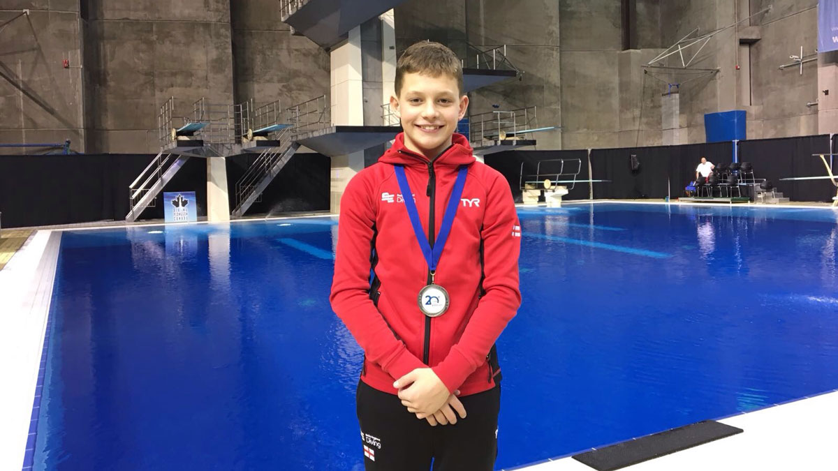 Ben Cutmore holds his silver medal from the CAMO Invitational 2017.
