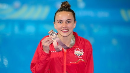 Toulson makes history with platform medal